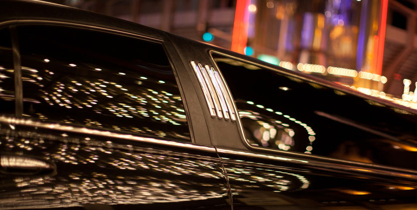 Stretch black limo used for limousine transportation for weddings, prom, airport service, and business travel