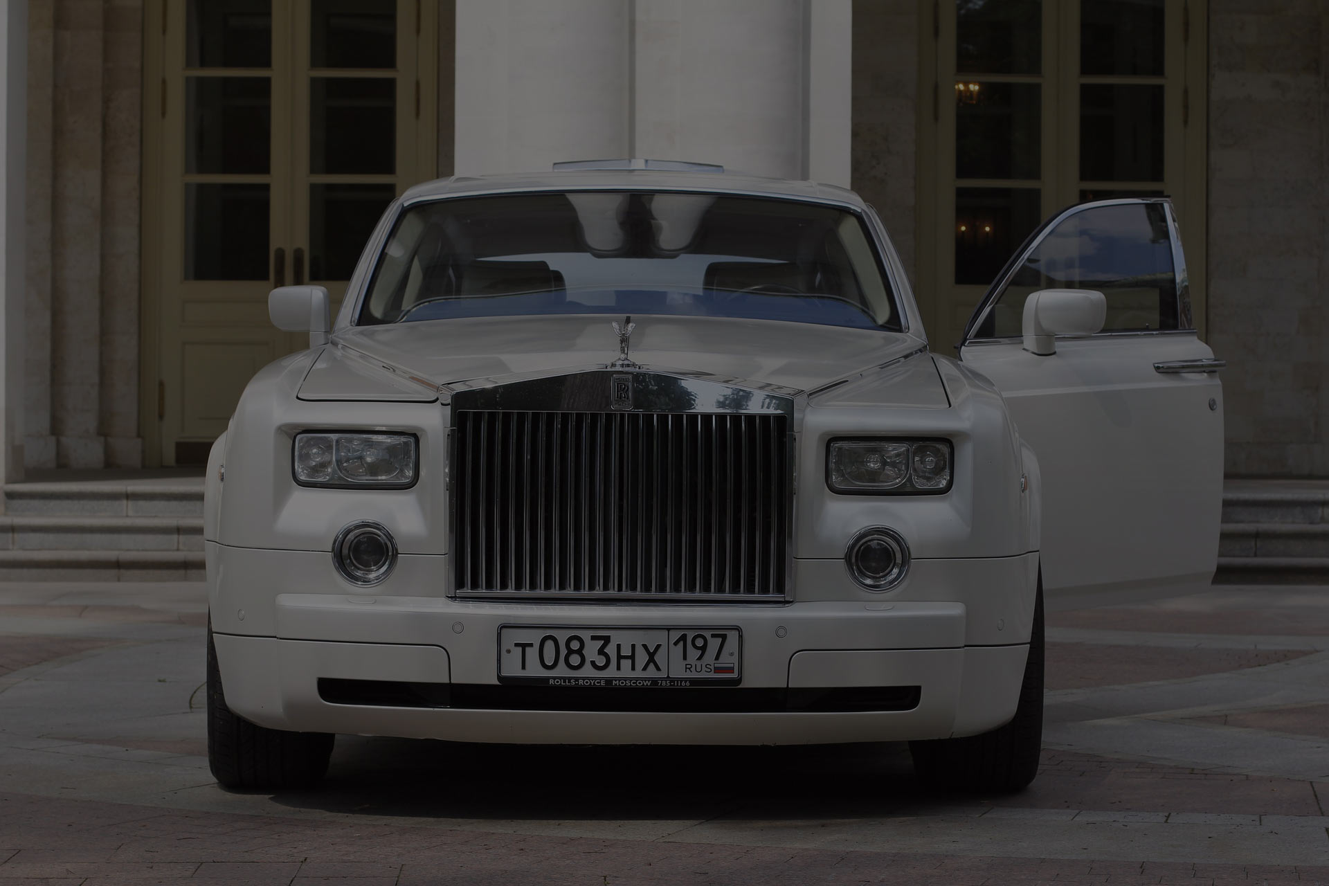 White luxury Rolls Royce that can be used for transportation service, for personal or business travel