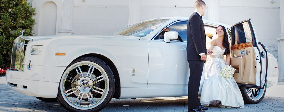 White luxury sedan used for wedding transportation service, with the bride and groom on their wedding day